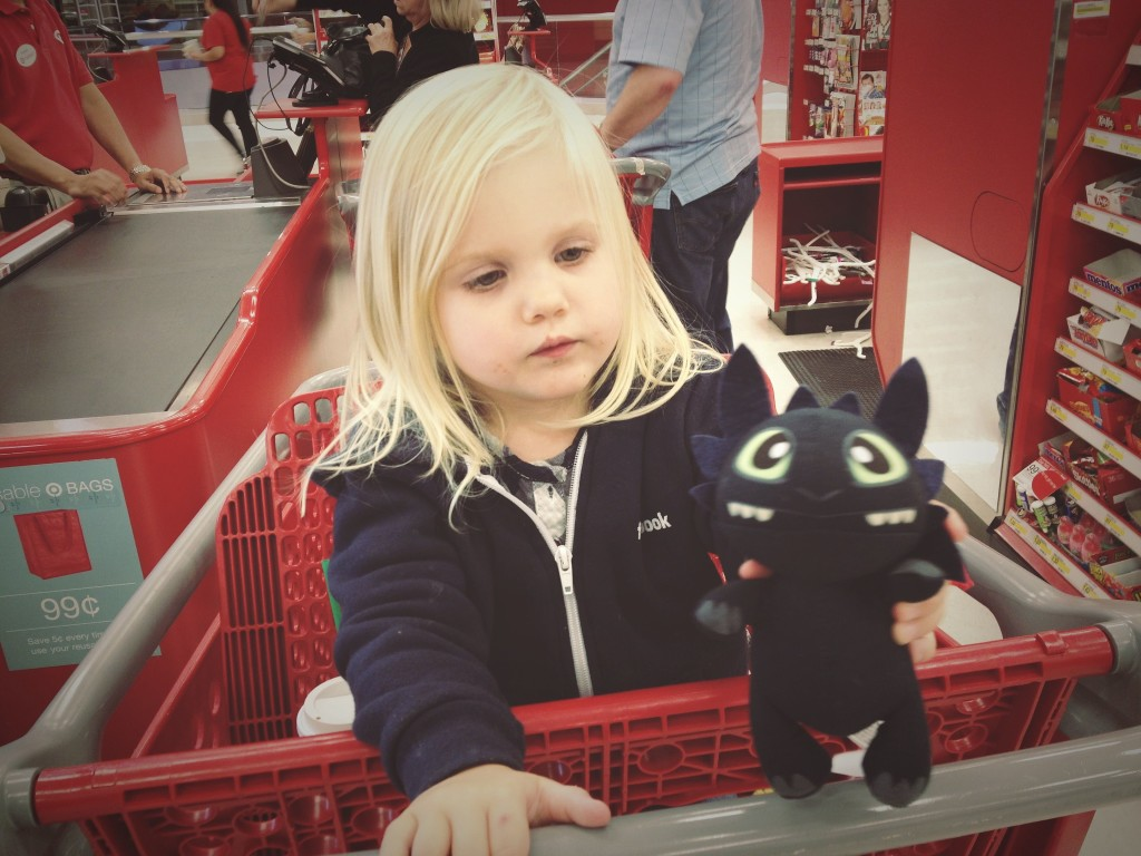 "Samantha with her gift she picked out. ""Toothless"" the dragon from How to Train Your Dragon."